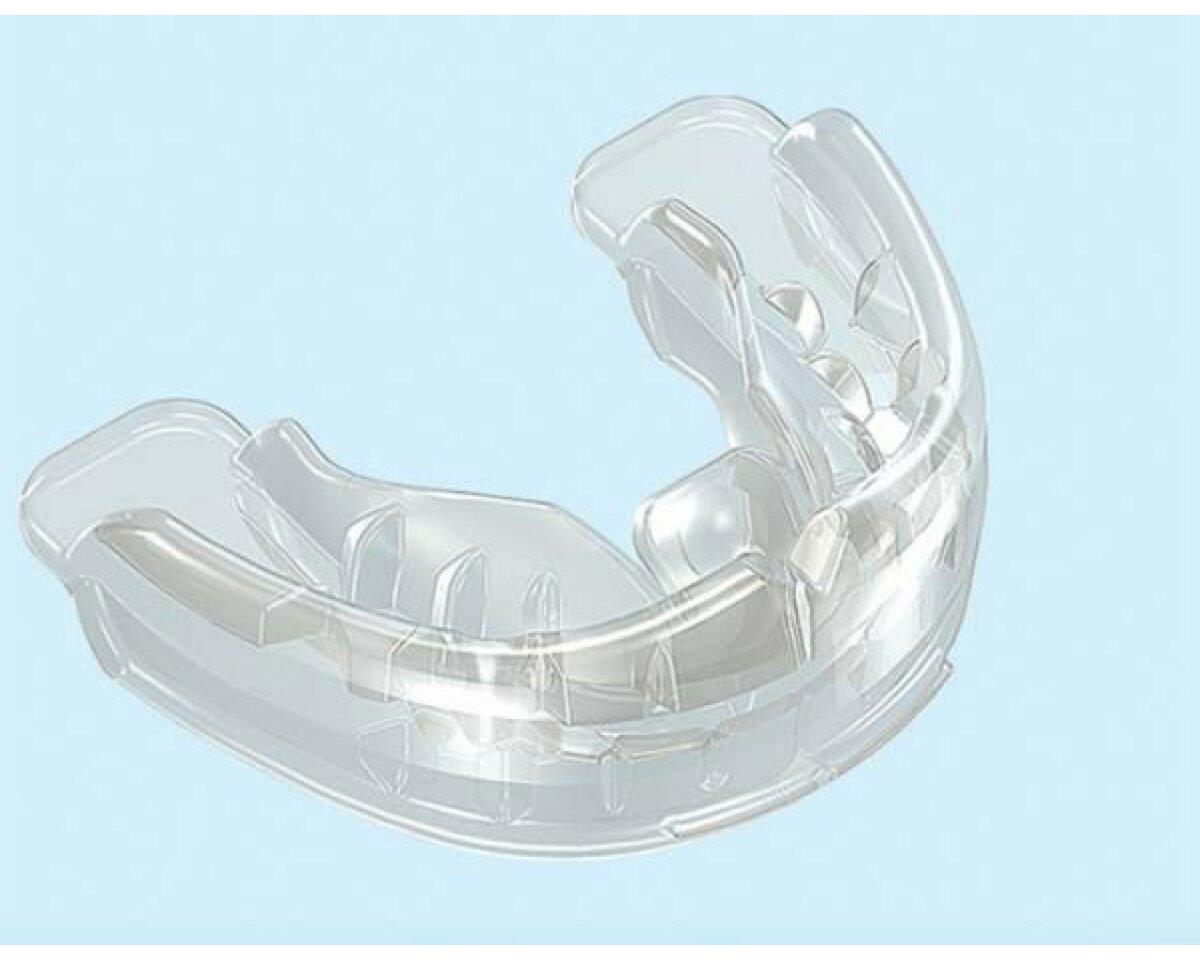 Капы для выравнивания зубов: какие бывают и как действуют