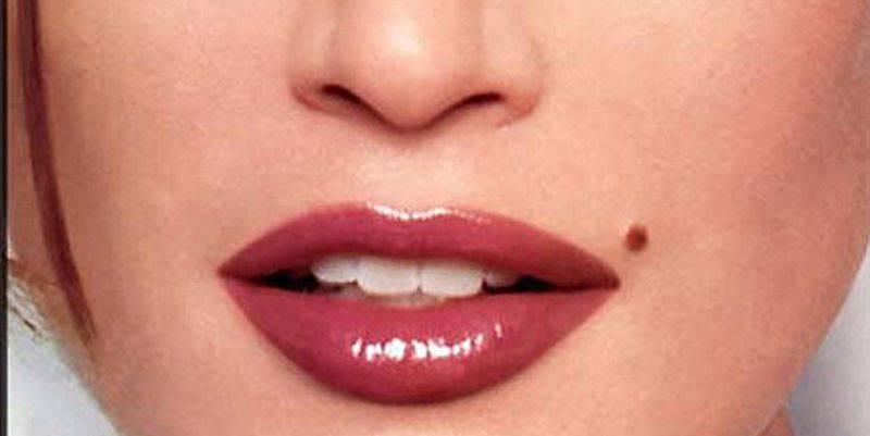 Что означает родинка на нижней губе справа