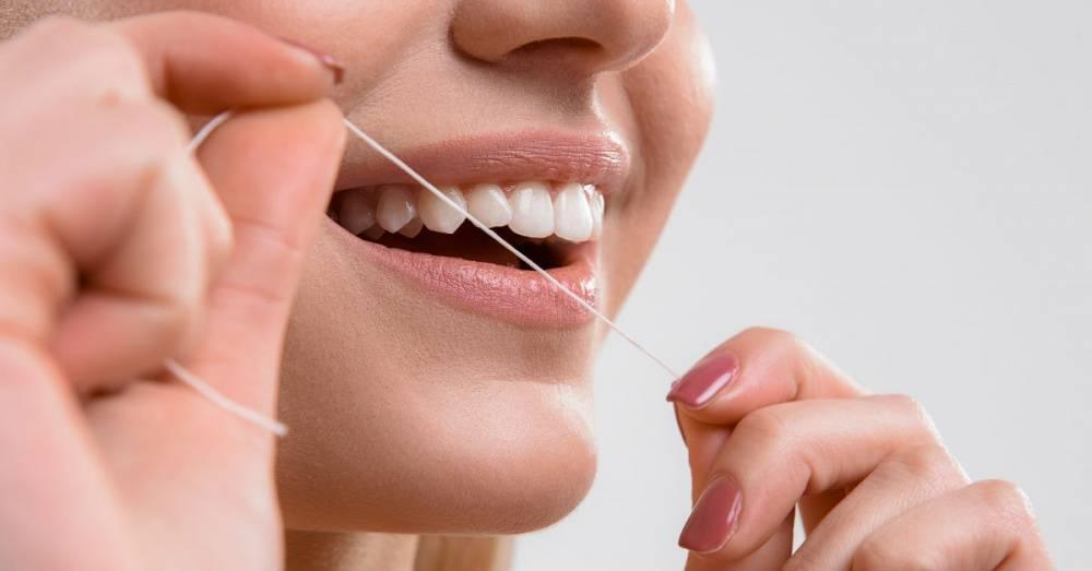 Как правильно пользоваться зубной нитью: полная инструкция