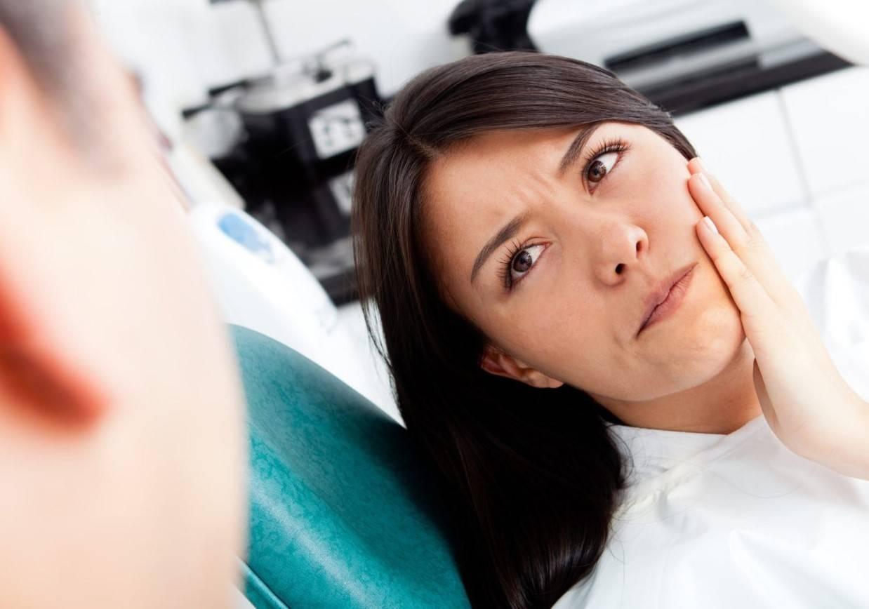 Болит ухо после удаления зуба
