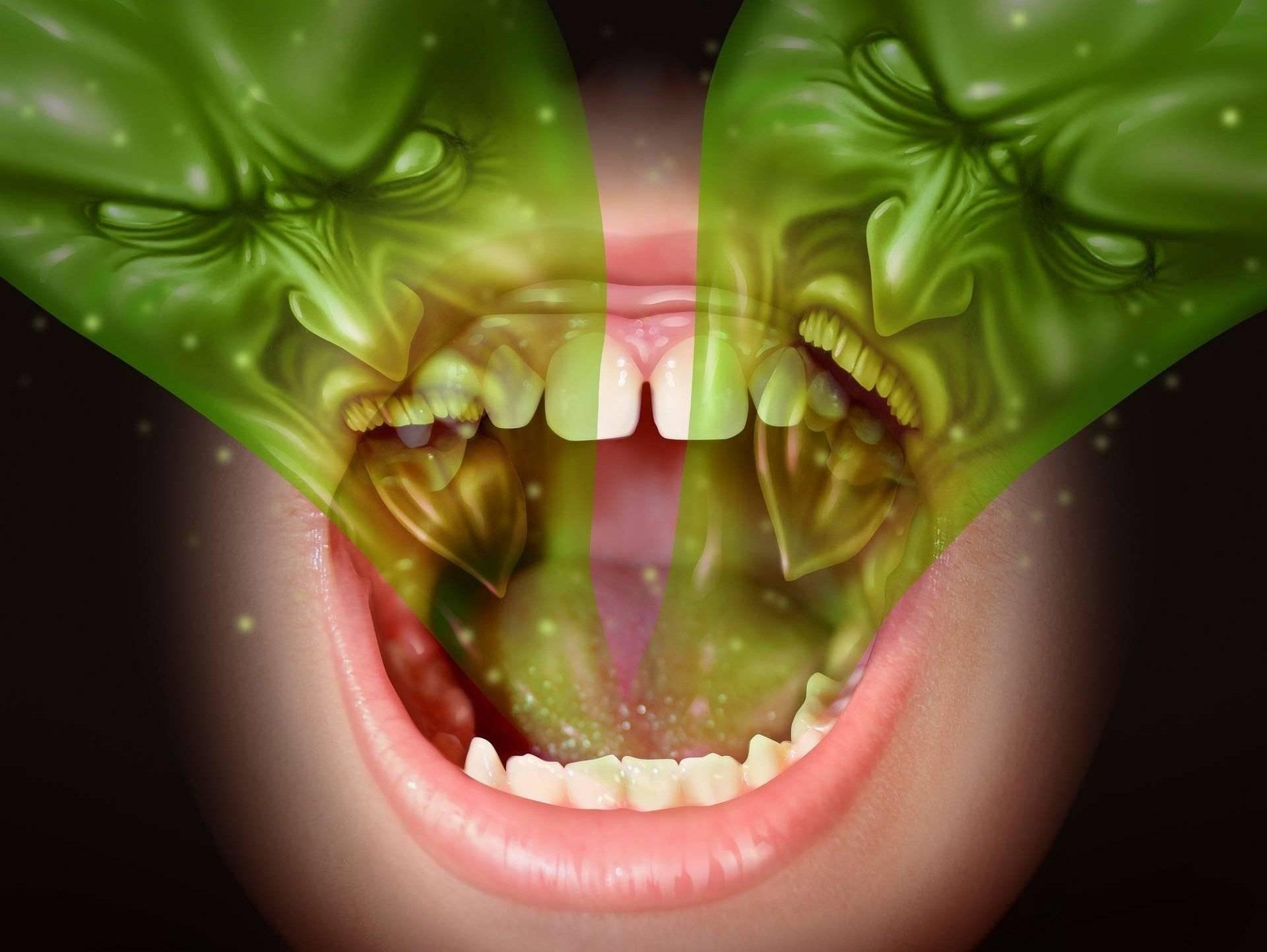 Запах изо рта при тонзиллите: причины появления