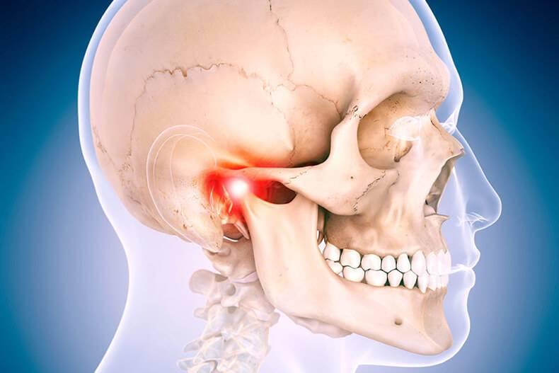 Почему хрустит челюсть при открывании рта?