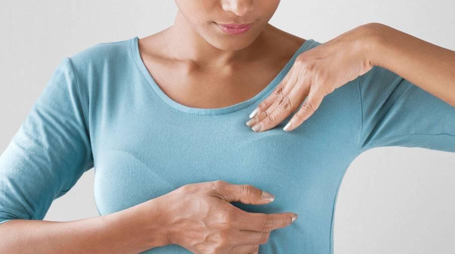 Почему болят грудные железы после месячных