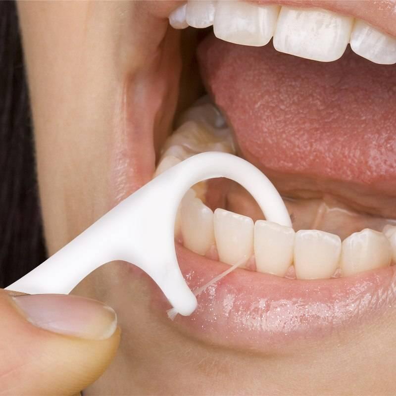 Почему в дырке или между зубами выросла десна что делать и как это лечить?