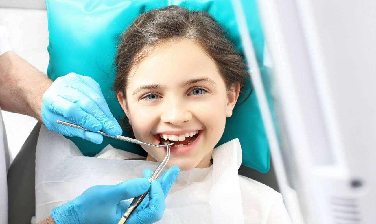 Как безболезненно вырвать зуб в домашних условиях