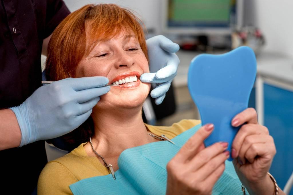Проблемы привыкания к съемным зубным протезам